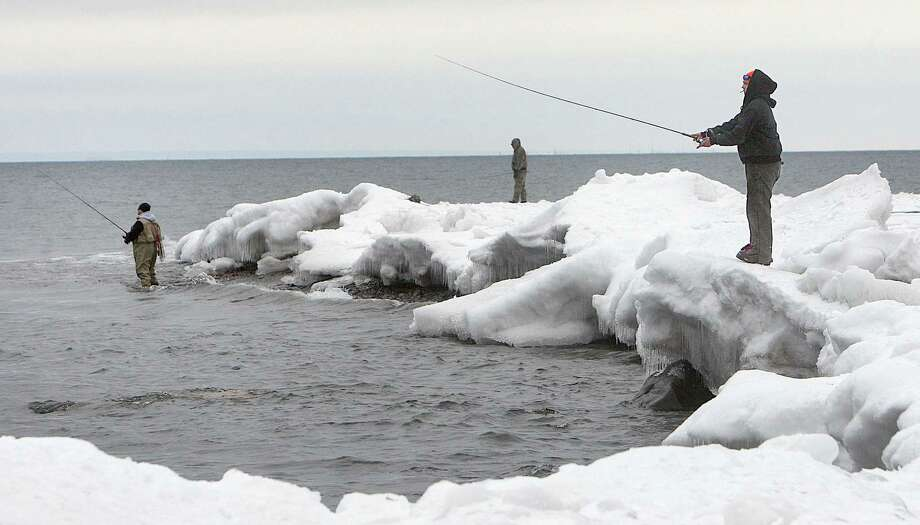 Anglers line the shore of Lake Superior near the French River recently while fishing for Kamloops rainbow trout. Photo: BOB KING, McClatchy-Tribune News Service / Duluth News-Tribune