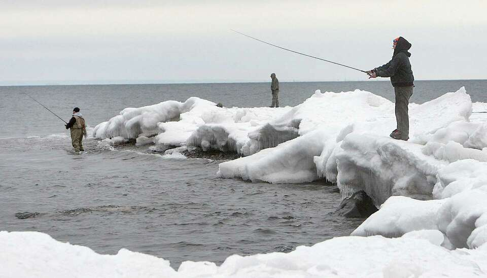 Anglers line the shore of Lake Superior near the French River recently while fishing for Kamloops ra