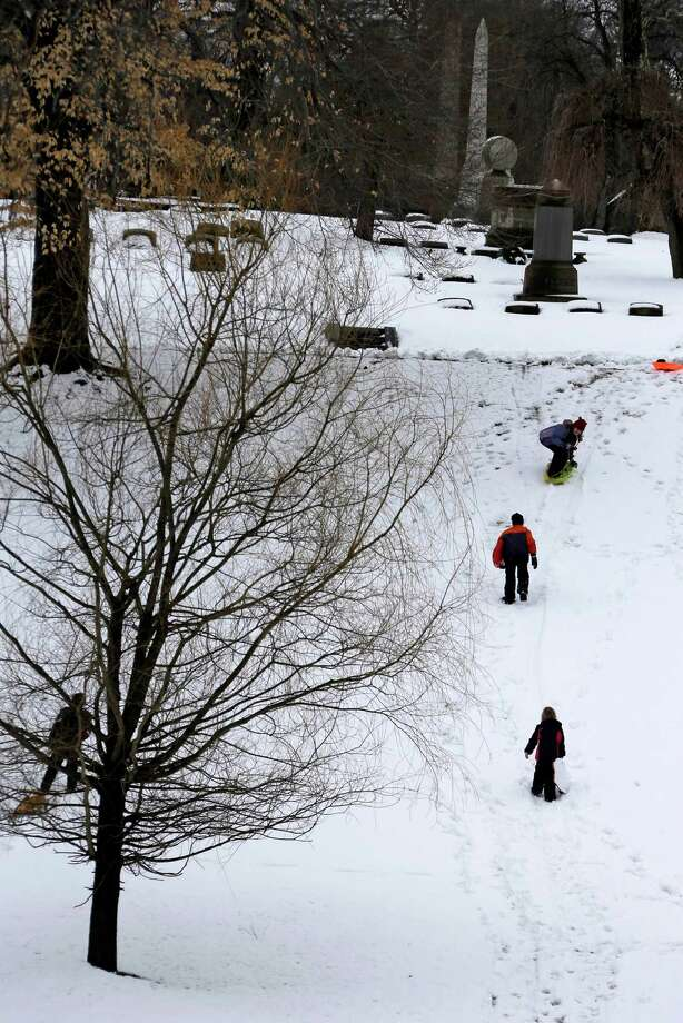 Sledding in the Homewood Cemetery was a way to spend a snow-day off school for Pittsburgh city school students,  Wednesday, March 6, 2013. By afternoon the 3-5 inches that fell in Pittsburgh was melting as temperatures neared 40 degrees. Photo: Gene J. Puskar, Associated Press / AP