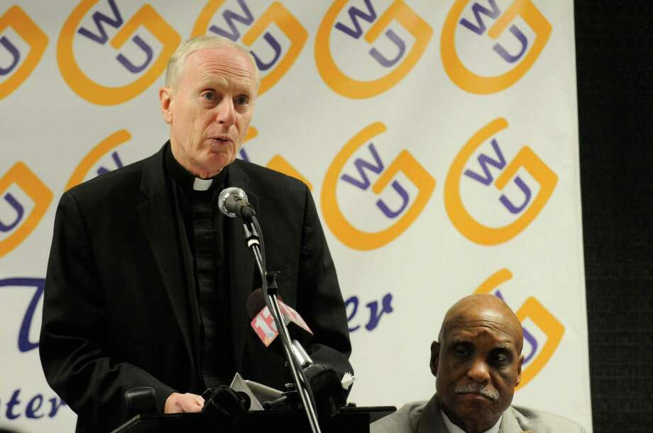Bishop of the Albany Roman Catholic Diocese, Howard J. Hubbard speaks during a press conference in support of Albany SNUG anti-violence initiative at the God With Us Center in Albany,NY Thursday, Jan.12, 2012. Reverend Dr. Edward B. Smart is pictured right. ( Michael P. Farrell/Times Union) Photo: Michael P. Farrell / 00016057A