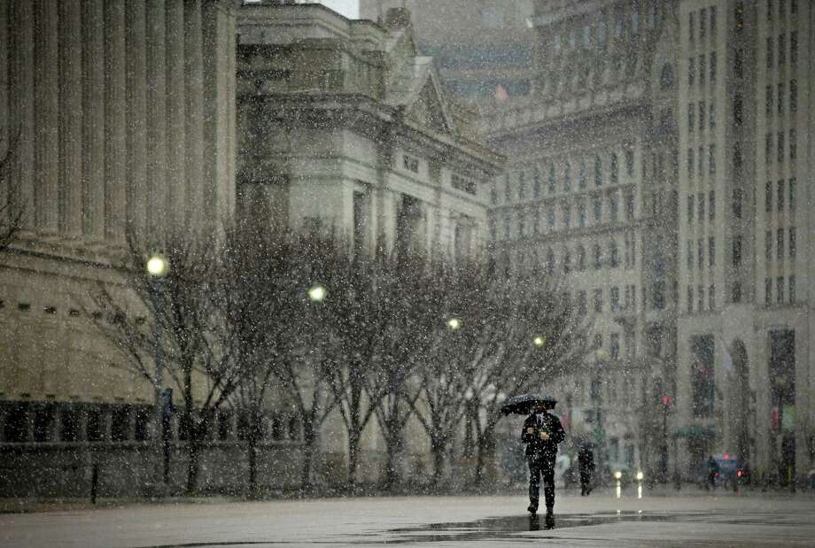 A pedestrian walks down Pennsylvania Ave near the White House in Washington, Wednesday, March 6, 2013. Schools, businesses and the federal government closed in anticipation of a snow storm that could blanket the region. Photo: Pablo Martinez Monsivais, Associated Press / AP