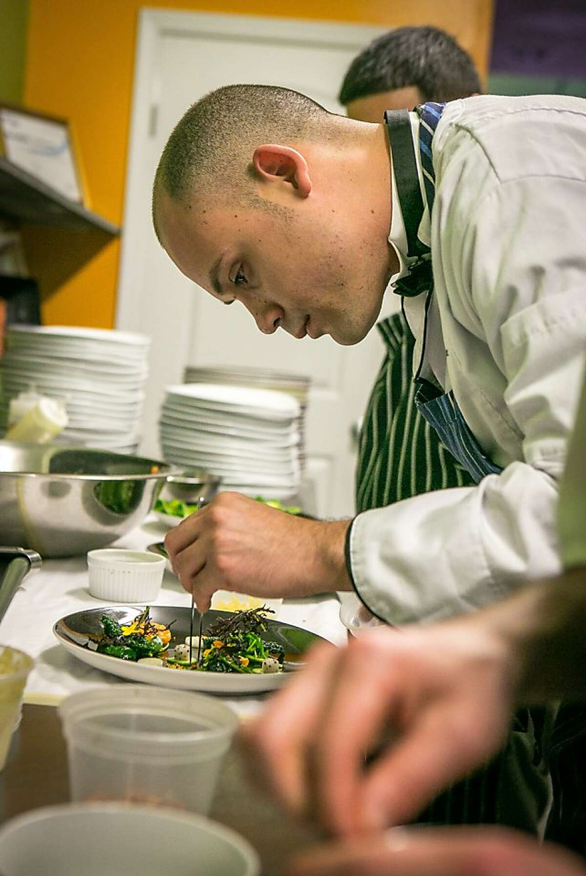 Chef Manny Torres Gimenez prepares a dish at Roxy's Cafe in San Francisco, Calif., is seen on Saturday, March 2nd, 2013.