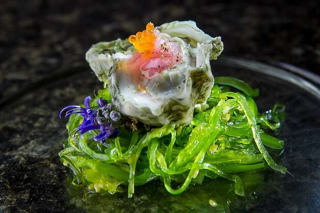 The kumamoto oyster with pickled ginger and onions on a nest of seaweed. Photo: John Storey, Special To The Chronicle