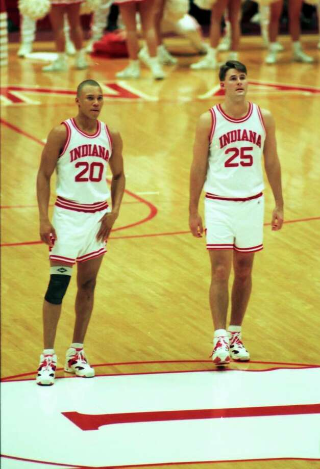 Lamar head coach Pat Knight (right) stands alongside Lamar assistant coach Sherron Wilkerson (left) while playing for the Indiana Hoosiers in a game against Minnesota on Jan. 26, 1994 in Assembly Hall. Photo: Indiana University