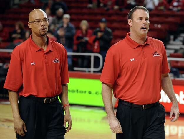 Lamar University assistant coach Sherron Wilkerson, left, and head coach Pat Knight, right, wait to award the senior basketball players on Senior Day at the Montagne Center on Saturday, March 2, 2013. Photo taken: Randy Edwards/The Enterprise