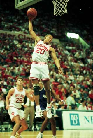 Lamar assistant coach Sherron Wilkerson pulls down a rebound for Indiana University in a game against TCU on Dec. 27, 1993, as Lamar head coach Pat Knight look on in the background. Photo: Indiana University