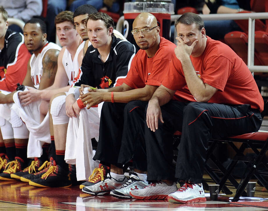 Lamar University assistant coach Sherron Wilkerson, left, and head coach Pat Knight, right, watch the Cardinals take on the Oral Roberts University Golden Eagles on Saturday, March 2, 2013. Photo taken: Randy Edwards/The Enterprise
