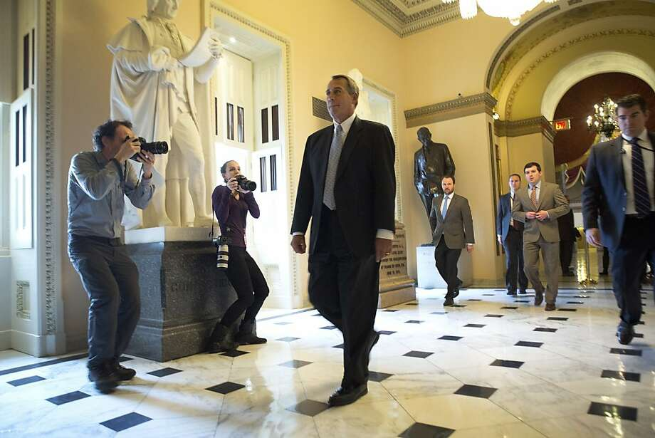Speaker John Boehner heads to the House floor to vote on a bill to extend the federal government's spending levels. Photo: Stephen Crowley, New York Times