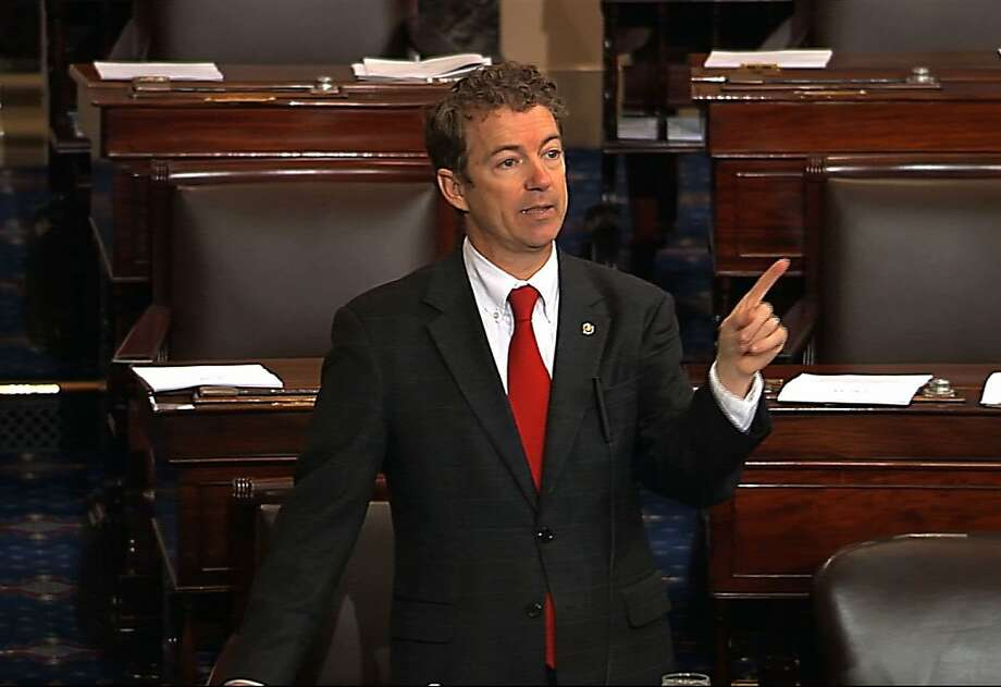 This video frame grab provided by Senate Television shows Sen. Rand Paul, R-Ky. speaking on the floor of the Senate on Capitol Hill in Washington, Wednesday, March 6, 2013. Senate Democrats pushed Wednesday for speedy confirmation of John Brennan's nomination to be CIA director but ran into a snag after a Paul began a lengthy speech over the legality of potential drone strikes on U.S. soil. But Paul stalled the chamber to start what he called a filibuster of Brennan's nomination. Paul's remarks were centered on what he said was the Obama administration's refusal to rule out the possibility of drone strikes inside the United States against American citizens.  (AP Photo/Senate Television) Photo: Associated Press