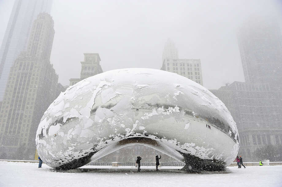 "The sculpture ""Cloud Gate"", commonly known as ""the bean,"" is covered in snow on March 5, 2013 in Chicago, Illinois. The worst winter storm of the season is expected to dump 7-10 inches of snow on the Chicago area with the worst expected for the evening commute. Photo: Brian Kersey, Getty Images / 2013 Getty Images"