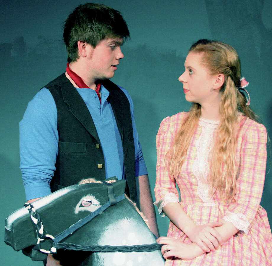 """Ben Bayers and Ashley Billings prep their roles as the tragically mismatched lovers, Billy Bigelow and Julie Jordan, during rehearsals for New Milford High School's production of Rodgers and Hammersteinís """"Carousel.""""  February 2013 Photo: Contributed Photo"""