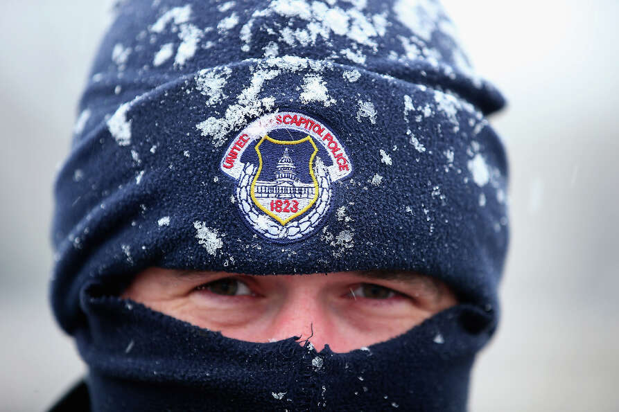 U.S. Capitol Police officer Alex Rys' hat is dusted with snow as he patrols on Capitol Hill March 6,