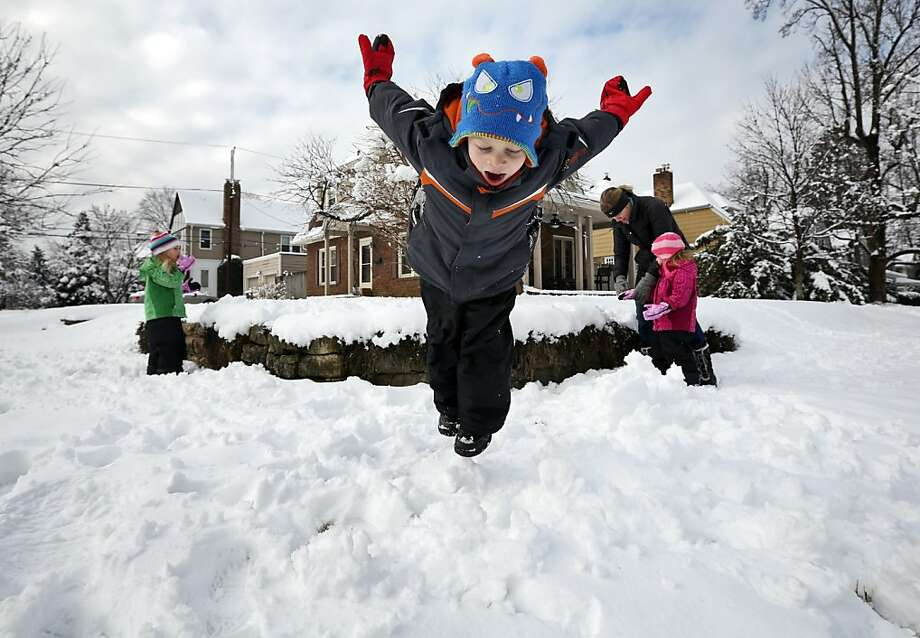 A family in Clintonville, Ohio, enjoys the snow a day after a storm pummeled the Midwest. Photo: Adam Cairns, Associated Press