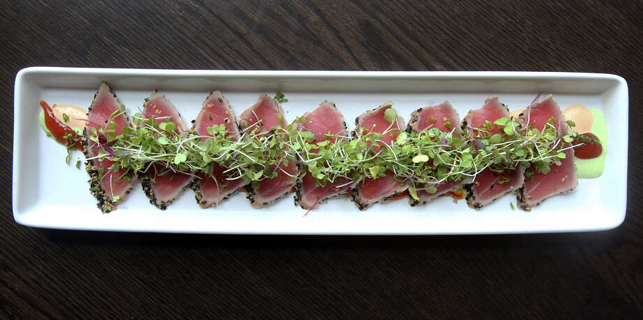 Crudo of hamachi, tuna and escolar is at Piranha Killer Sushi. Photo: Express-News File Photo