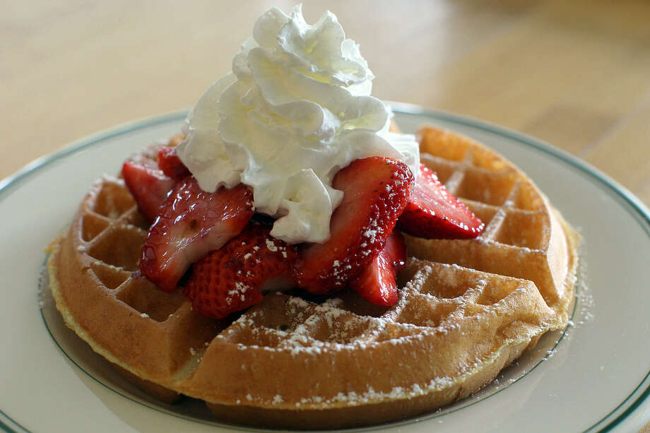 "The strawberry waffle is a popular breakfast, 606 Embassy Oak, Suite 100, 10333 Huebner Road, 210-496-0828 (both locations). Featured on ""Diners, Drive-Ins and Dives,"" the lines are long for the great food. Photo: Express-News File Photo"
