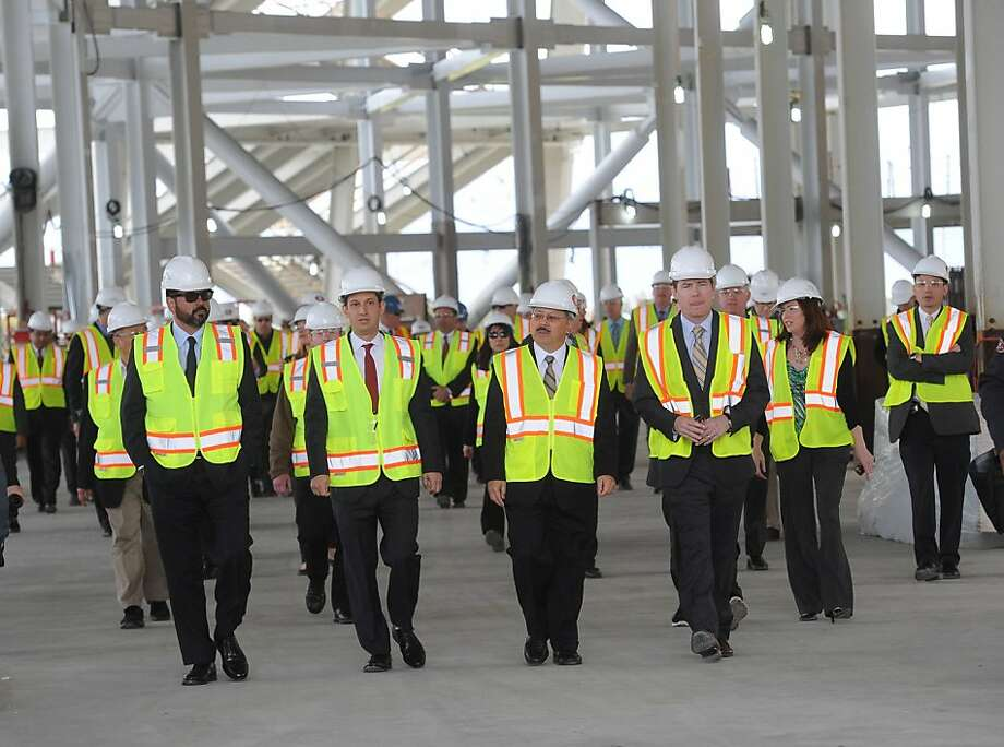 Super Bowl committee Chair Daniel Lurie and S.F. Mayor Ed Lee (second and third from left) at the 49ers new stadium during bid planning to host the 50th. Photo: Susana Bates, Special To The Chronicle