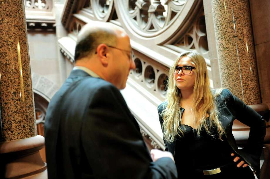 Ronda Rousey, women's world champion of the Ultimate Fighting Championship, right, talks with Steve Greenberg of the UFC on Wednesday, March 6, 2013, at the Capitol in Albany, N.Y. (Cindy Schultz / Times Union) Photo: Cindy Schultz / 10021464A