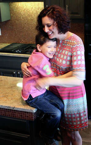 Carey Morgan and her son, Axel, spend a lot of time together in the kitchen of their home. Axel, 5, has been helping his mom prepare food since he was 18-months-old. Photo: Cynthia Esparza, San Antonio Express-News / San Antonio Express-News