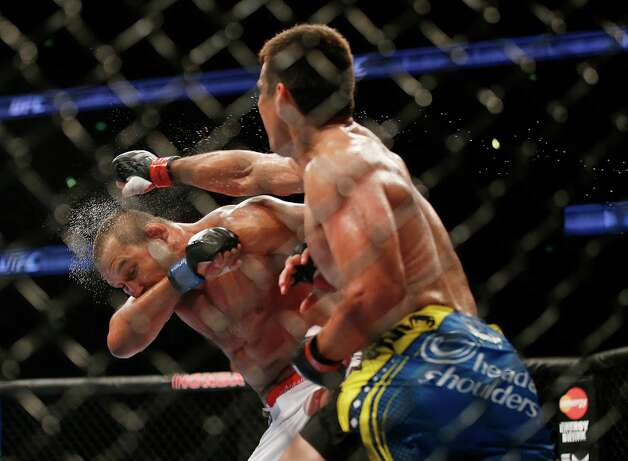 Lyoto Machida, right, of Brazil, lands a punch to the face of  Dan Henderson during their UFC 157 light heavyweight mixed martial arts match in Anaheim, Calif., Saturday, Feb. 23, 2013. Machida won by split decision after the third round. Photo: Jae C. Hong, AP / AP