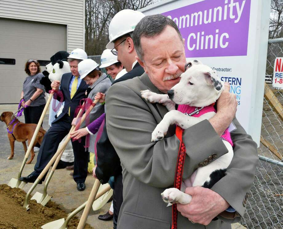 Animal Protective Foundation executive director Michael Daugherty, at right. holds a puppy as other dignitaries break ground for APF's new Community Spay/Neuter Clinic in Glenville Wednesday March 6, 2013.   (John Carl D'Annibale / Times Union) Photo: John Carl D'Annibale / 10021430A