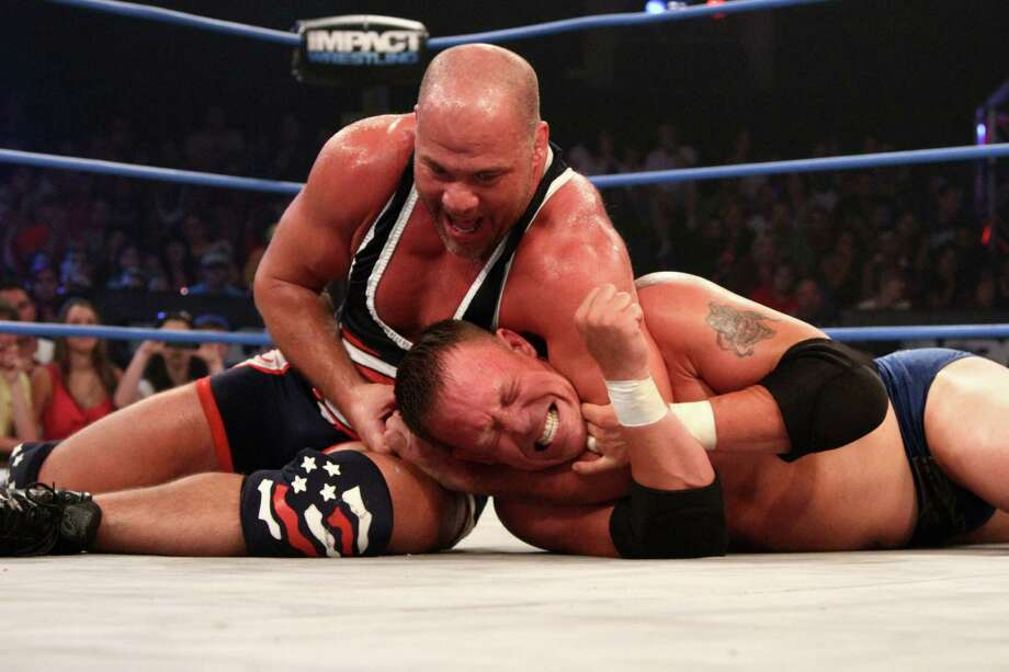 Kurt Angle (left, applying a headlock to Mr. Anderson), will take on Wes Brisco in a Lockdown cage match. A Fan InterAction is planned in conjunction with Lockdown. Photo: Courtesy Photo