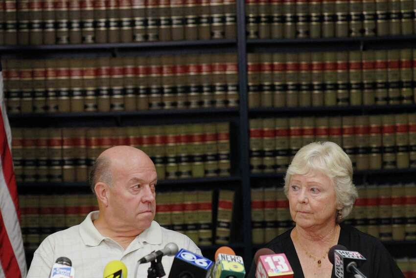 Taylor Wilson, left, and his wife Jennie Wilson, from Ogden, UT, talk about their daughter, Karen Wilson, a senior at University at Albany, who disappeared in 1985 while returning to campus. The Wilson?s were at the New York State Police Academy for a press conference on Thursday, July 19, 2007. (Paul Buckowski/Times Union archive)