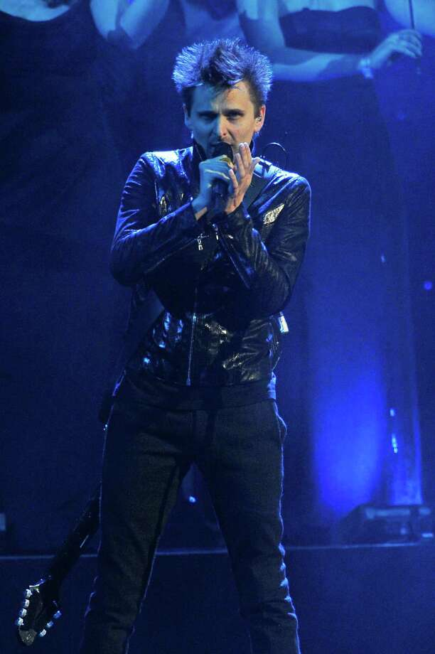 Muse, with Matthew Bellamy, will perform Tuesday at the Toyota Center in Houston. Photo: Matt Kent / Getty Images