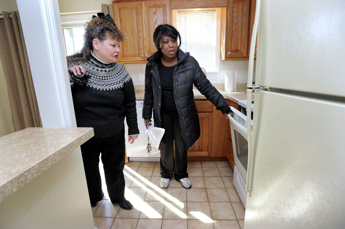 Carolyn Ridenour, 47, left, a Realtor with Prudential Connecticut Realty, shows Ranisha Green, 25, of Danbury, an apartment for rent at Racing Brook Meadow 1 in Danbury, Conn. Tuesday, March 5, 2013