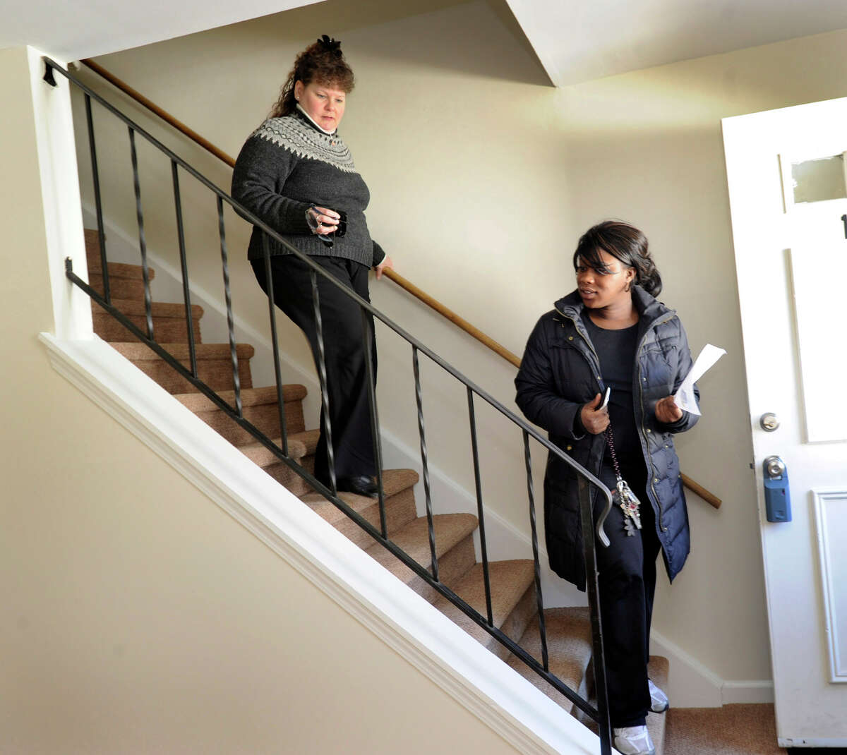Carolyn Ridenour, 47, left, of Prudential Connecticut Realty, shows Ranisha Green, 25, of Danbury, an apartment for rent at Racing Brook Meadow 1 in Danbury, Conn. Tuesday, March 5, 2013