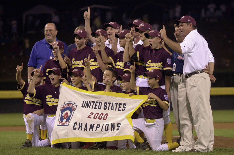Looking back: Bellaire's 2000 All-Star team is all smiles with their championship banner after winning the U.S. title in the Little League World Series. Photo: SMILEY N. POOL / HOUSTON CHRONICLE