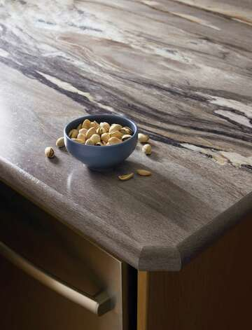 New options in laminate countertops, such as the Dolce Vita pattern in Formica's 180fx, give the look of granite, down to the bullnose edge. Photo: Scott Dorrance, Courtesy Formica / (c) 2011 Scott Dorrance