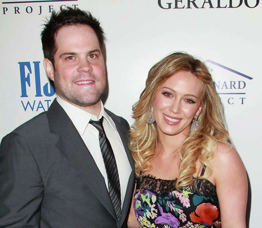 Actress Hilary Duff married professional hockey player Mike Comrie when she was 22. They recently welcomed a baby boy to their family. Photo: Getty Images