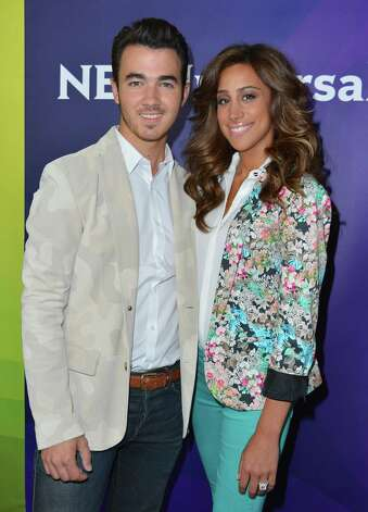 Singer Kevin Jonas broke the hearts of Jonas Bros. fans when he married Danielle Jonas in 2009 when he was 22. Photo: Alberto E. Rodriguez, Getty Images / 2012 Getty Images