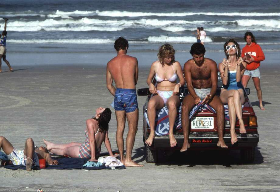 The more things change, the more they stay the same. College kids from ... 1986 catch sun rays during Spring Break. (Photo by Robert Alexander/Archive Photos/Getty Images) Photo: Robert Alexander, Multiple / 1983 Robert Alexander