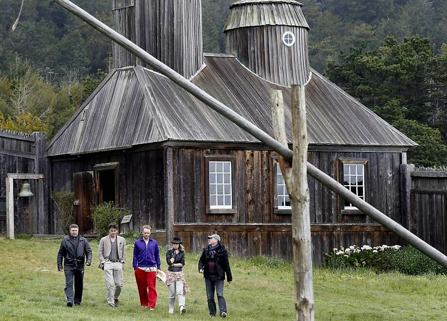 Members of the Russian film crew walk past the chapel at Fort Ross on Tuesday during their four days in Northern California filming the epic movie that takes its name from the historical site in Sonoma County. Photo: Brant Ward, The Chronicle
