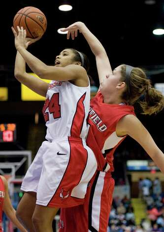 Marist's Corielle Yarde, left, is guarded by Fairfield's Brittany MacFarlane, right, in the first half of an NCAA college basketball game for the championship of the Metro Atlantic Athletic conference women's tournament in Springfield, Mass., Monday, March 5, 2012.  (AP Photo/Jessica Hill) Photo: Jessica Hill, Associated Press / AP2012