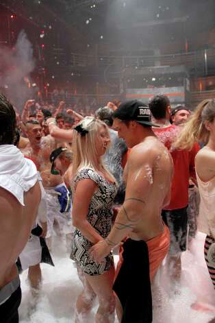 Spring Break revelers enjoy a foam party at a nightclub in the resort city of Cancun, Mexico, on Monday. (AP Photo Israel Leal) Photo: Multiple