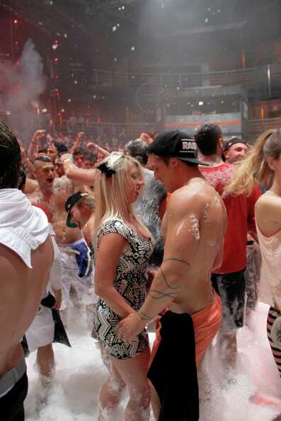 Spring Break revelers enjoy a foam party at a nightclub in the resort city of Cancun, Mexico, on Mon