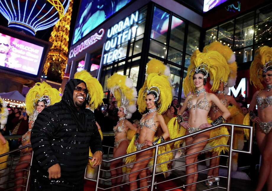"Just walking around will give off that vibe of decadence. Cee-Lo being welcomed by showgirls from the Bally's Las Vegas show ""Jubilee!""  (Photo by Isaac Brekken/WireImage) Photo: Isaac Brekken, Multiple / 2013 WireImage"