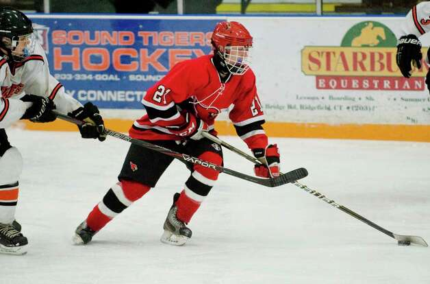 Greenwich High School's Ian Fulton brings the puck up the ice during the Division I boys ice hockey playoffs against Ridgefield High School, played at Ridgefield. Mar. 6, 2013 Photo: Scott Mullin / The News-Times Freelance
