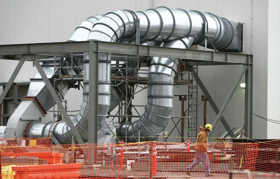 A worker walks in the under-construction Waste Treatment Plant shown during a tour of the Hanford Nuclear Reservation. Construction of the facility has been curtailed as technology to deal with the large amounts of dangerous waste are developed. Photo: JOSHUA TRUJILLO / SEATTLEPI.COM