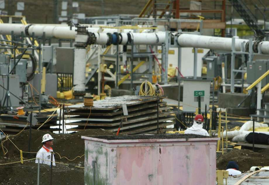 A worker is shown in a trench at C-Tank Farm during a tour of the Hanford Nuclear Reservation. Photo: JOSHUA TRUJILLO / SEATTLEPI.COM