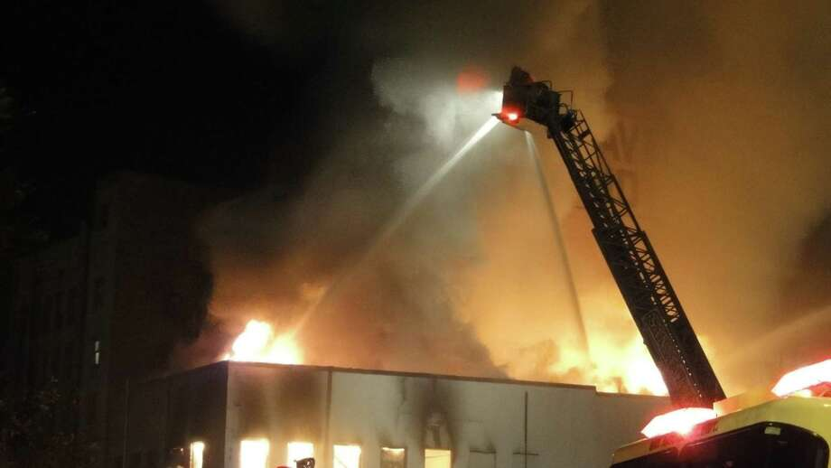 A fire broke out downtown just after 7 p.m. and 28 units from the San Antonio Fire Department responded. The fire appears to have started in the former Frisky-A-Go-Go club in the 200 block of Broadway. Photo: Merrisa Brown / MySA.com