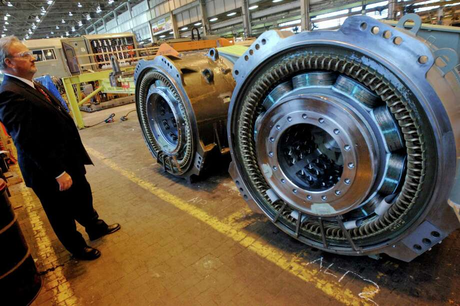 Robert W. Donohue, General Electric Co. commercial marketing leader, looks at alternators for locomotives at the GE Transportation plant in Erie, Pennsylvania, U.S., on Monday, May 18, 2009. General Electric Co. may build a passenger locomotive in the U.S. as President Barack Obama seeks to create a national network of high-speed corridors, the head of GE's transportation said in an interview today. GE is the world's biggest maker of locomotives. Photographer: Doug Benz/Bloomberg News Photo: DOUG BENZ, BLOOMBERG NEWS