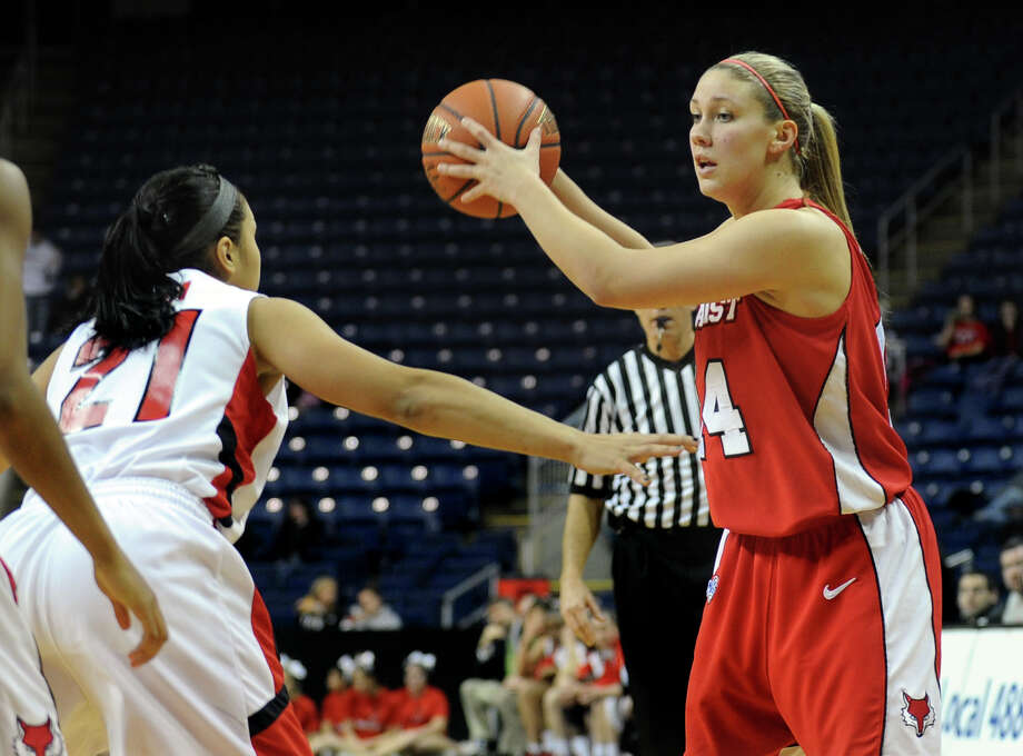 Marist's #14 Casey Dulin looks to pass the ball as Fairfield University's #21 Desiree Pina, left, blocks, during womens basketball action at the Webster Bank Arena in Bridgeport, Conn. on Thursday January 12, 2012. Photo: Christian Abraham / Connecticut Post