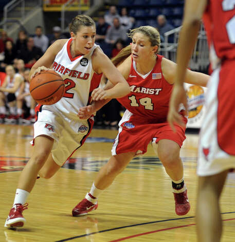 Fairfield University's #12 Katelyn Linney, left, drives to the basket as Marist's #14 Casey Dulin blocks, during womens basketball action at the Webster Bank Arena in Bridgeport, Conn. on Thursday January 12, 2012. Photo: Christian Abraham / Connecticut Post