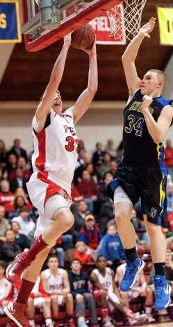 Tim Butala, Fairfield Prep, goes up for a shot as Newington high school's Bryant Morander tries to stop him during a second round 2013 CIAC class LL boys basketball tournament game held at Alumni Hall, Fairfield University, Fairfield CT on Wednesday March 6th 2013. Photo: Mark Conrad / Connecticut Post Freelance