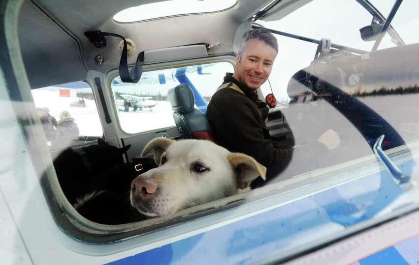 Iditarod Air Force pilot Scott Ivany prepares to take off with a load of dropped dogs in his Cessna