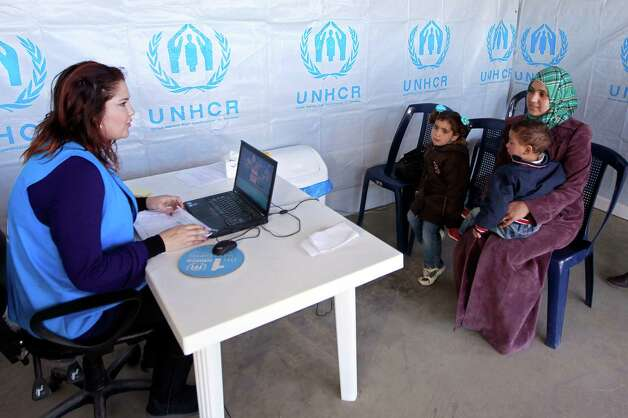 "Syrian refugee Bushra, 19, registers at the UNHCR center in the northern city of Tripoli, Lebanon, Wednesday, March. 6, 2013.  The number of Syrians who have fled their war-ravaged country and are seeking assistance has now topped the one million mark, the United Nations' refugee agency said Wednesday warning that Syria is heading towards a ""full-scale disaster."" (AP Photo/Bilal Hussein) Photo: Bilal Hussein"