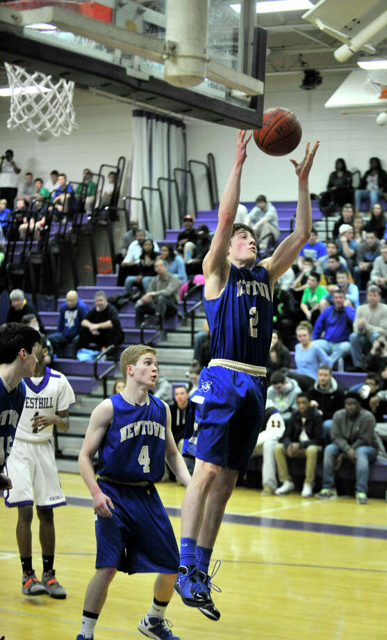 Newtown's Connor Quinn reaches for a rebound during the Nighthawk's game against Westhill at Westhill High School on Wednesday, March 6, 2013. Westhill won, 56-34. Photo: Jason Rearick / The Advocate